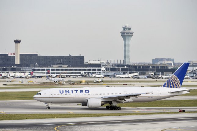 A United Airlines plane taxis at O'Hare International Airport, where a passenger was physically removed from a flight on Sunday. File Photo by Brian Kersey/UPI