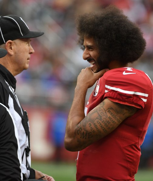 Former San Francisco 49ers quarterback Colin Kaepernick jokes with an official during a game against the New York Jets last season. Photo by Terry Schmitt/UPI