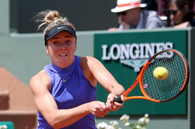 Elina Svitolina of Ukraine hits a shot during her French Open women's quarterfinal match against Simona Halep of Romania at Roland Garros in Paris on June 7, 2017. File photo by David Silpa/UPI