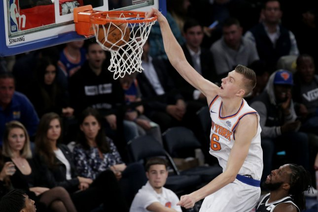 New York Knicks Kristaps Porzingis dunks the basketball in the first half against the Brooklyn Nets at Madison Square Garden in New York City on Friday. Photo by John Angelillo/UPI