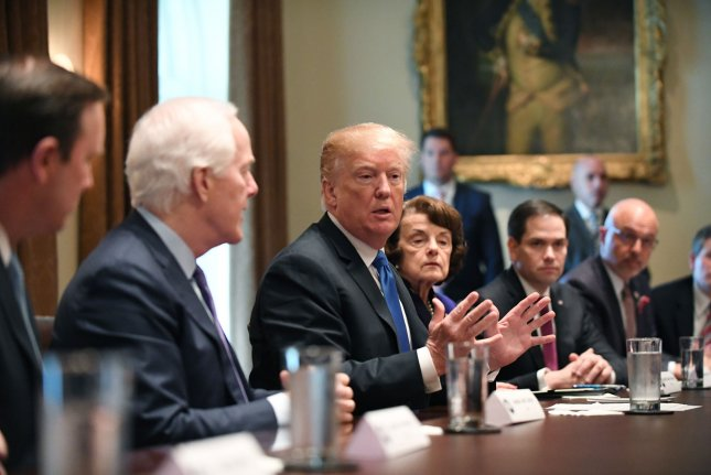 President Donald Trump makes a comment as he meets with bipartisan members of Congress to discuss gun safety in the Cabinet Room of the White House in Washington, D.C., on Wednesday. Photo by Pat Benic/UPI