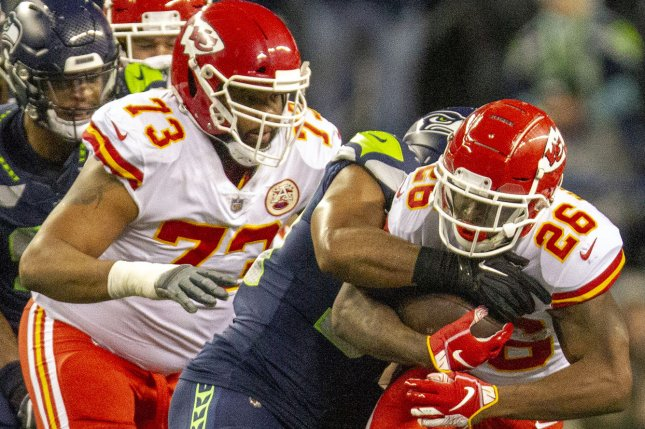 Kansas City Chiefs running back Damien Williams (26) is tackled by Seattle Seahawks middle linebacker Bobby Wagner (54) as Jeff Allen (73) looks on during the second quarter on December 23 at CenturyLink Field in Seattle. Photo by Jim Bryant/UPI
