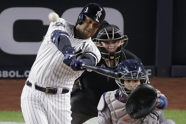 New York Yankees outfielder Aaron Hicks is expected to miss eight to 10 months following the procedure. Photo by Ray Stubblebine/UPI