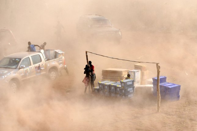 Dust rises from the ground as a helicopter of the UN Mission in Sudan (UNMIS) takes off. (UPI/Tim McKulka/UN)