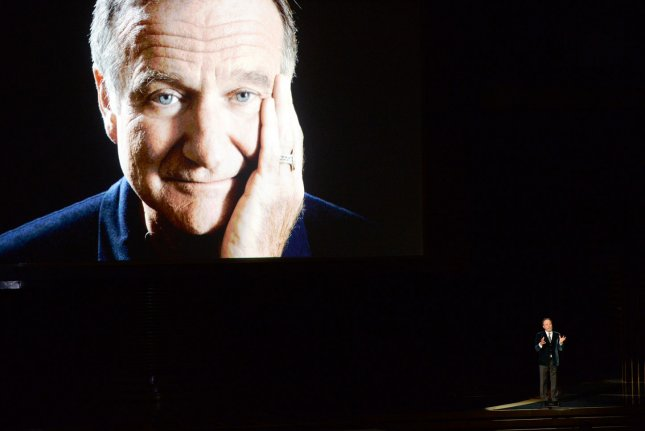 Robin Williams is seen on screen as Billy Crystal speaks during an In Memoriam tribute during the Primetime Emmy Awards at the Nokia Theatre in Los Angeles on August 25, 2014. UPI/Pat Benic