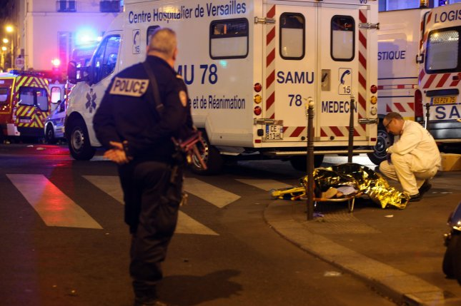 Victims of the shooting at the Bataclan concert venue in central Paris are evacuated to receive first aid Friday. More than one hundred people were killed and many more wounded when gunmen opened fire inside the venue as the French capital was the target of a series of deadly attacks. Photo by Maya Vidon-White/UPI