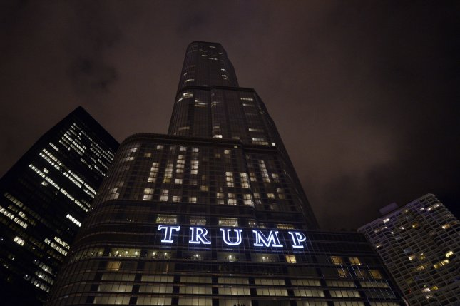 The Trump Tower in Chicago is adorned with a giant sign as it rises in the skyline on October 4, 2014. Policy experts and advisers are wondering whether Trump's vast business dealings might present him with serious conflicts of interest in his administration unprecedented in the American presidency. File Photo by Brian Kersey/UPI
