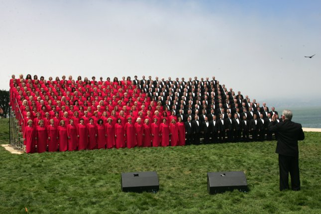 Members of the Mormon Tabernacle Choir sing while making an IMAX movie in the Golden Gate National Recreation Area in San Francisco on June 29, 2005. One member of the choir quit the group because she doesn't want to sing in the presidential inauguration. File photo byTerry Schmitt/UPI