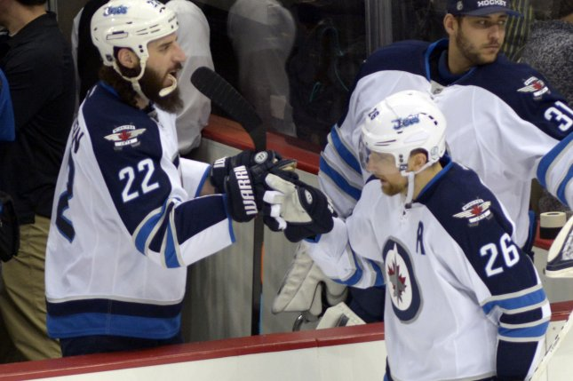 The Winnipeg Jets edged the Vancouver Canucks 2-1 on Sunday night, hanging on for their playoff lives in front of a jubilant hometown crowd. File Photo by Archie Carpenter/UPI