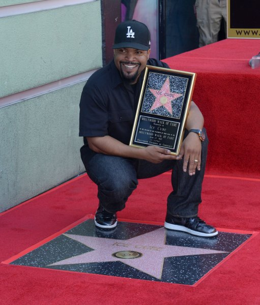 Actor, director, producer and music icon Ice Cube holds a replica plaque during an unveiling ceremony honoring him with the 2,6014th star on the Hollywood Walk of Fame in Los Angeles on June 12. Photo by Jim Ruymen/UPI