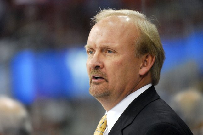 Former NHL head coach Lindy Ruff watches one of his former teams during the first period. File photo by Grant Halverson/UPI