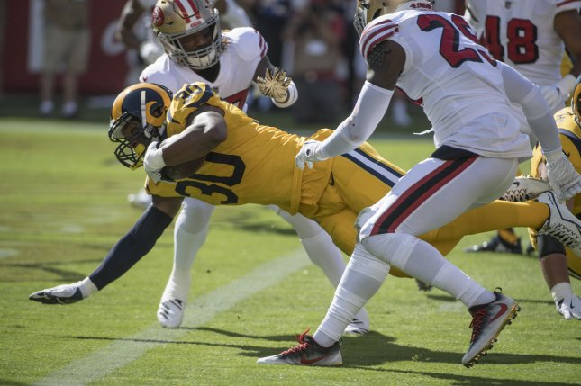 Los Angeles Rams running back Todd Gurley II (30) dives over the goal line for a seven-yard touchdown in the second quarter against the San Francisco 49ers on October 21, 2018 at Levi's Stadium in Santa Clara, California. Photo by Terry Schmitt/UPI