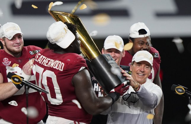 Alabama Crimson Tide head coach Nick Saban celebrates with offensive lineman Alex Leatherwood (70) and other players after a 52-24 victory over the Ohio State Buckeyes in the 2021 NCAA National Championship football game at Hard Rock Stadium in Miami on Monday. Photo by Hans Deryk/UPI