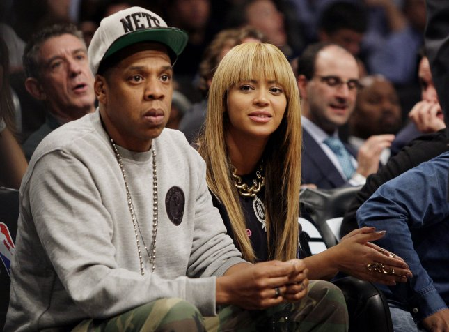 Beyonce and Jay-Z watch the Brooklyn Nets play the New York Knicks at the Barclays Center in New York City on November 26, 2012. UPI/John Angelillo