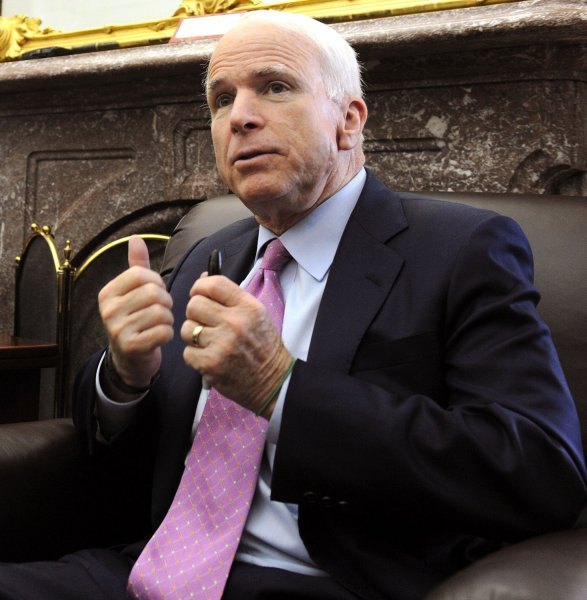 Sen. John McCain, R-AZ, speaks to the media after the Senate voted to end production of the F-22 fighter on Capitol Hill in Washington on July 21, 2009. (UPI Photo/Roger L. Wollenberg)