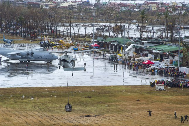 A U.S. Navy MH-60S Seahawk helicopter drops relief supplies as the U.S. military assist in relief efforts in the wake of Typhoon Haiyan, in Tacloban, Leyte province, Philippines, Nov. 14, 2013. U.S. Military personnel are assisting the Philippine Armed Forces in providing humanitarian assistance and disaster relief to affected areas throughout the Philippines following the deadly typhoon that left 2,357 dead. UPI/Ricardo R. Guzman/US Navy
