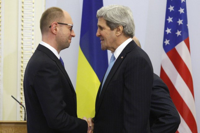 U.S. Secretary of State John Kerry (R) shakes hands Ukrainian Prime Minister Arseniy Yatsenyuk before their meting in Kiev on March, 4, 2014. Kerry announced a $1 billion economic package in support of the new government, while Russian President Vladimir Putin says he reserves the right to use force in the Ukraine as a last resort. (UPI/Ivan Vakolenko)