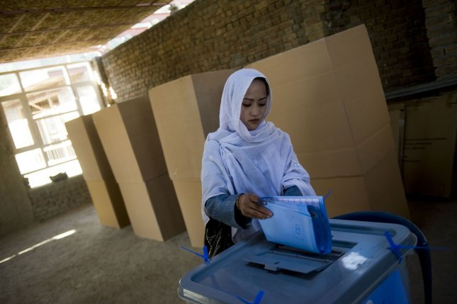 Afghan woman casts her ballot for the parliamentary elections in Kabul, Afghanistan, on Saturday, September 18, 2010. (UPI/Hossein Fatemi)