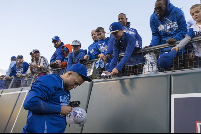 Kansas City Royals' Kelvin Herrera signs autographs before game 2 of the World Series against the New York Mets at Kauffman Stadium in Kansas City, Missouri on October 28, 2015. Photo by Kevin Dietsch/UPI