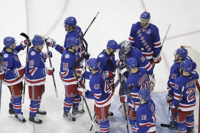 New York Rangers Henrik Lundqvist celebrates with teammates after the game against the Montreal Canadiens in game 4 of their Eastern Conference first round series of the NHL Stanley Cup Playoffs at Madison Square Garden in New York City on April 18, 2017. File photo by John Angelillo/UPI
