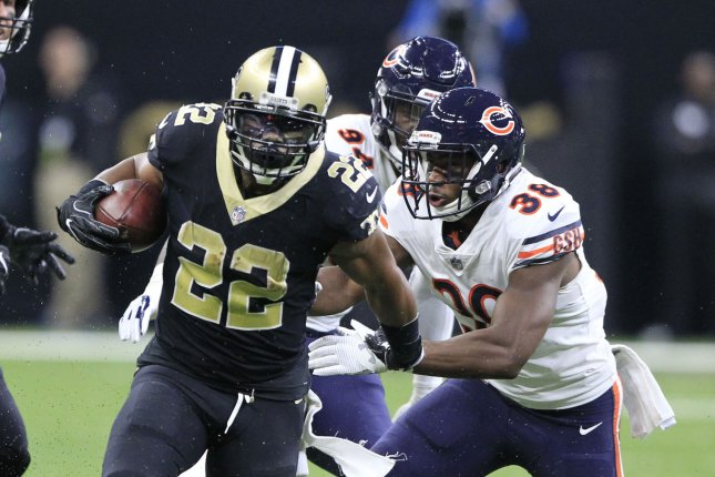 New Orleans Saints running back Mark Ingram (22) sprints passed Chicago Bears strong safety Adrian Amos (38) and outside linebacker Leonard Floyd (94) in enroute to 18 yards gain at the Mercedes-Benz Superdome in New Orleans October 29, 2017. Photo by AJ Sisco/UPI