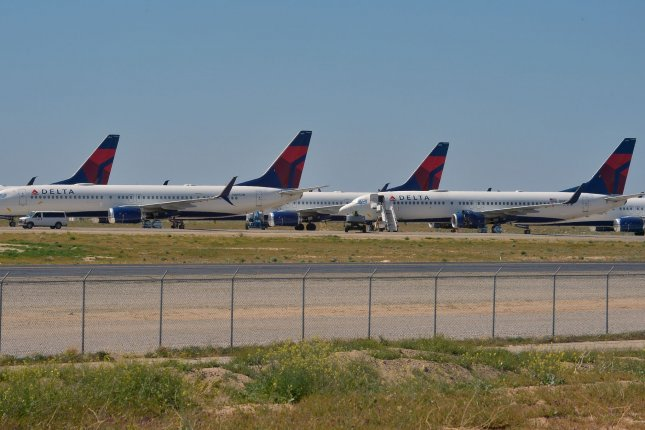 Grounded commercial aircraft are seen parked at Victorville Logistics Airport in Victorville, Calif., on April 22. The IEA report cited low demand for aviation fuel as a major factor in its revised forecasts. File Photo by Jim Ruymen/UPI