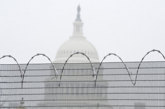 Fencing and razorwire still provide security in the aftermath of rioting at the U.S. Capitol.  Photo by Mike Theiler/UPI