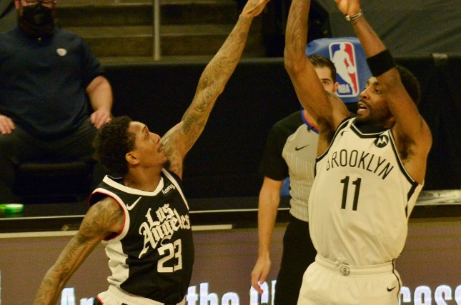 Brooklyn Nets guard Kyrie Irving (R) is averaging 28.1 points and 5.7 assists per game this season. File Photo by Jim Ruymen/UPI