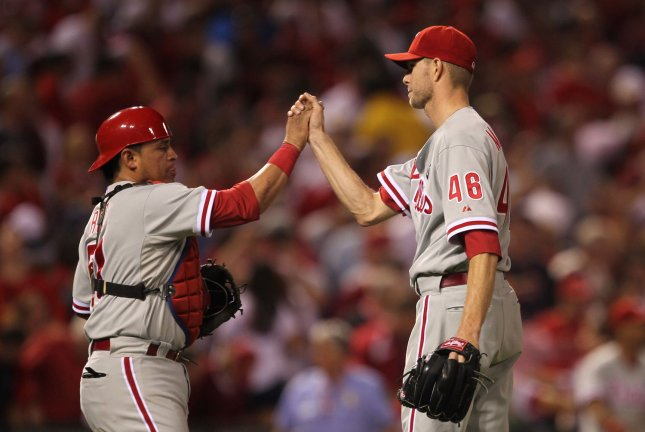 Philadelphia Phillies catcher Carlos Ruiz (L) congratulates pitcher Ryan Madson after the third out and a 3-2 win over the St. Louis Cardinals in Game 3 of the NLDS at Busch Stadium in St. Louis, Oct. 4, 2011. UPI/Bill Greenblatt
