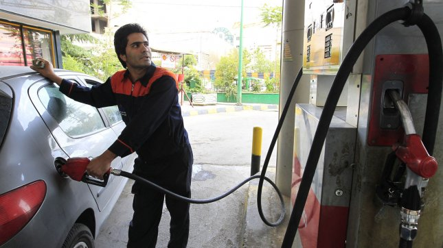 An Iranian man pumps petrol into his car at a gas station in Tehran, Iran on May 16, 2012. UPI/Maryam Rahmanian