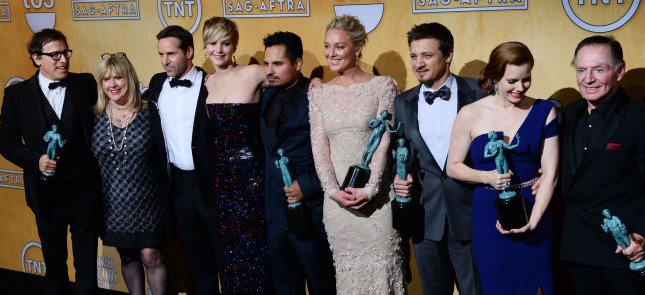 Writer-director David O. Russell (L) appears backstage with American Hustle cast members Colleen Camp, Alessandro Nivola, Jennifer Lawrence, Michael Pena, Elisabeth Rohm, Jeremy Renner, Amy Adams and Paul Herman after the movie was named Best Film during the 20th annual SAG Awards held at the Shrine Auditorium in Los Angeles on January 18, 2014. UPI/Jim Ruymen