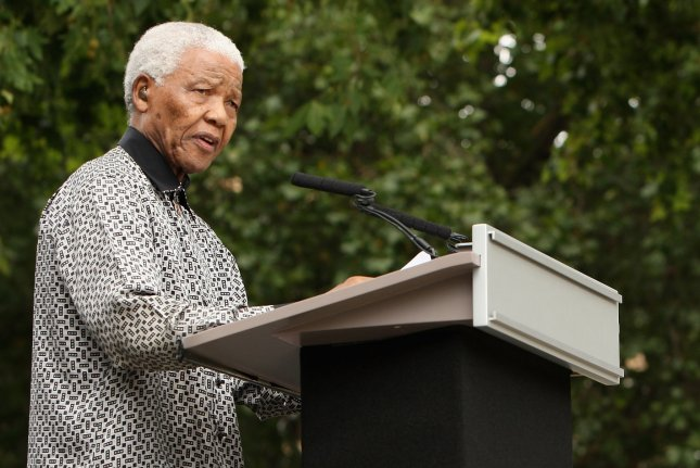 Nelson Mandela speaks during an unveiling ceremony of a statue depicting Mandela at Parliament Square in London on August 29, 2007. (File/UPI Photo/Daniel Berehulak/POOL)