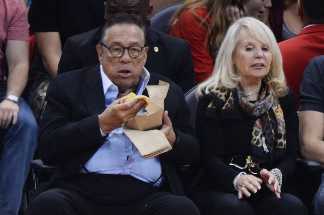 Los Angeles Clippers owner Donald Sterling sits court side with his wife, Rochelle Sterling, at Game 1 in the first round of the Western Conference playoff series against the Golden State Warriors at Staples Center in Los Angeles on April 19, 2014. (File/UPI/Jim Ruymen)