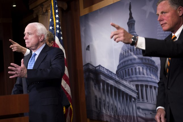 Sen. John McCain (R-AZ) and Sen. Jeff Flake (R-AZ) speaks at a press conference on the proposed Veterans Affairs bill, on Capitol Hill in Washington, D.C. on June 3, 2014. UPI/Kevin Dietsch