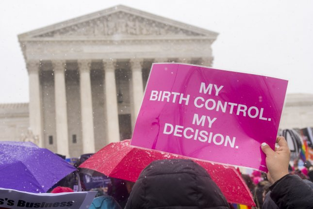 Women's rights supporters participate in a rally in front of the Supreme Court as the Court considers two cases brought by Hobby Lobby and Conestoga Wood involving religious objections to the birth control mandate in the Affordable Care Act, in Washington, D.C. on March 25, 2014. UPI/Kevin Dietsch