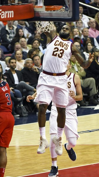 Cleveland Cavaliers forward LeBron James rises for a dunk in a game against the Washington Wizards earlier this month. Photo by Mark Goldman/UPI