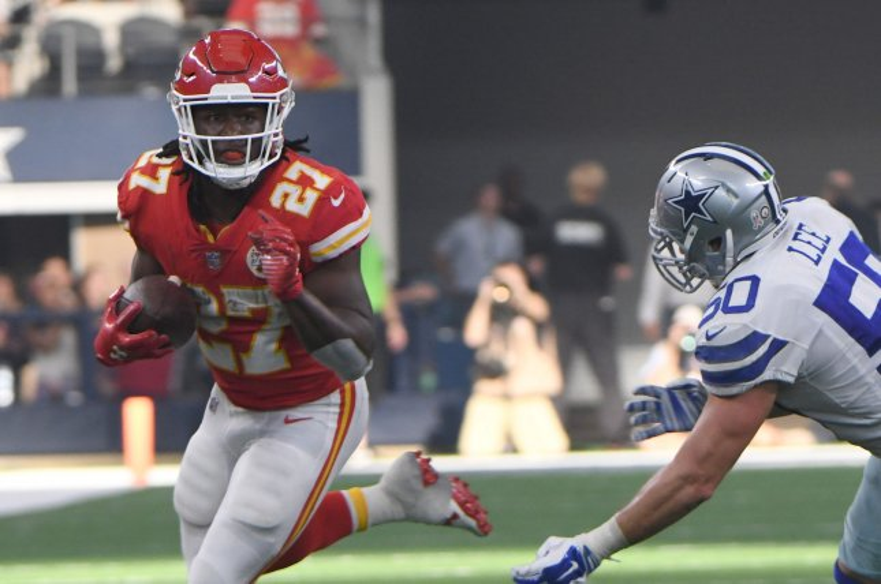 Kansas City Chiefs running back Kareem Hunt turns up field as Dallas Cowboys linebacker Sean Lee closes in during the first half on November 5, 2017 at AT&T Stadium in Arlington, Texas. Photo by Ian Halperin/UPI