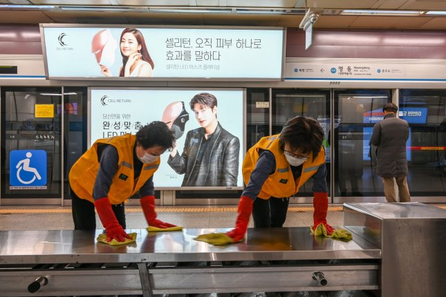 Workers clean the Myeongdond subway station to protect against coronavirus in Seoul on Wednesday.  Photo by Thomas Maresca/UPI