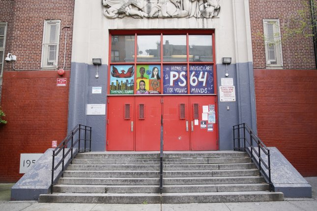 The doors to P.S. 64 Joseph P. Addabbo are closed after public schools were closed for the remainder of the school year in New York City in May. Photo by John Angelillo/UPI