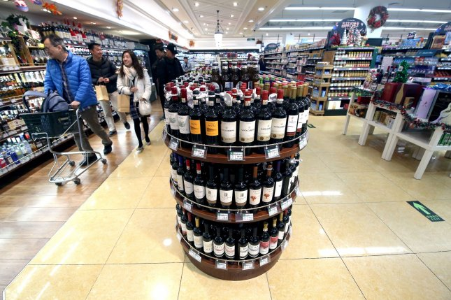 Chinese shoppers peruse the wine aisle at an international supermarket in Beijing, China, on, December 22, 2019. On Thursday, China imposed stiff tariffs on Australian wine, accusing the Oceania country of price dumping. Photo by Stephen Shaver/UPI