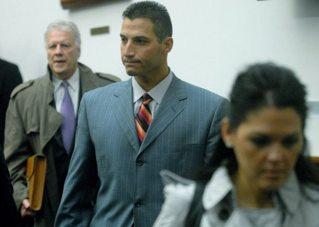 New York Yankees pitcher Andy Pettitte (C) leaves a meeting with .House Oversight and Government Reform Committee regarding his alleged use of steroids and other performance enhancing drugs in Washington on February 4, 2008. Pettitte was joined by his wife Laura (R) and Attorney Jay Reisinger. (UPI Photo/Kevin Dietsch)