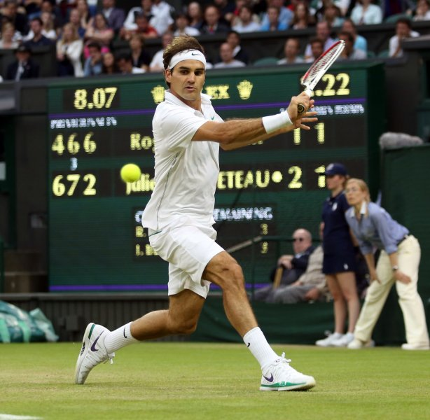Roger Federer, shown in last year's Wimbledon Championships, needed to rally Monday before claiming a a first-round win at the Dubai Duty Free Tennis Championships. UPI/Hugo Philpott