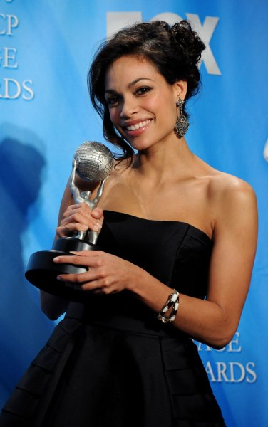 Rosario Dawson appears backstage with the award she garnered for outstanding actress in a motion picture for Seven Pounds, at the 40th NAACP Image Awards in Los Angeles on February 12, 2009. (UPI Photo/Jim Ruymen)