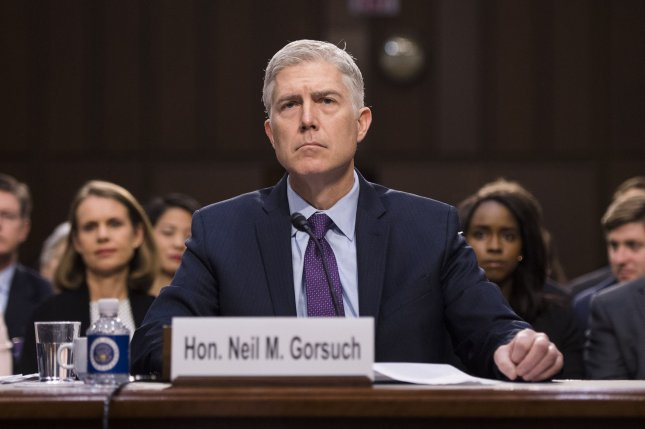 Supreme Court Justice nominee Neil Gorsuch testifies during his confirmation hearing before the Senate Judiciary Committee on Capitol Hill in Washington, D.C. on Tuesday. Gorsuch said he would have walked out the door if President Donald Trump had asked him to overturn Roe v. Way. Photo by Kevin Dietsch/UPI