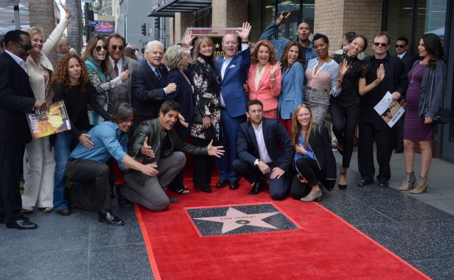 Producer Ken Corday (C) waves as he is joined by Days of Our Lives cast members during an unveiling ceremony honoring him with the 2,612th stair on the Hollywood Walk of Fame in Los Angeles on May 15. File Photo by Jim Ruymen/UPI