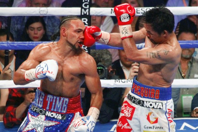 Manny Pacquiao (R) is 62-7-2 after beating Keith Thurman on Saturday night. Photo by James Atoa/UPI