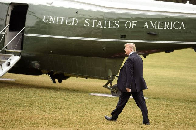 President Donald Trump walks on the South Lawn to Marine One helicopter as he departs the White House for his estate at Mar-a-Lago, Florida in February. Photo by Mike Theiler/UPI