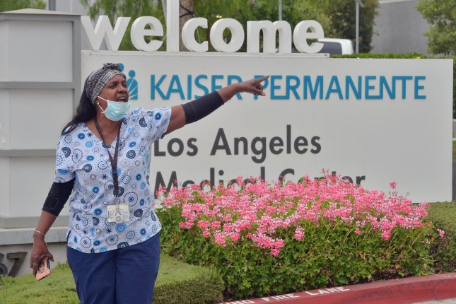 Nurses and healthcare workers stage a Juneteenth action to peacefully protest the lack of police accountability and demand justice for local communities and an end to systemic racism, in Los Angeles, Calif., on June 19. File Photo by Jim Ruymen/UPI