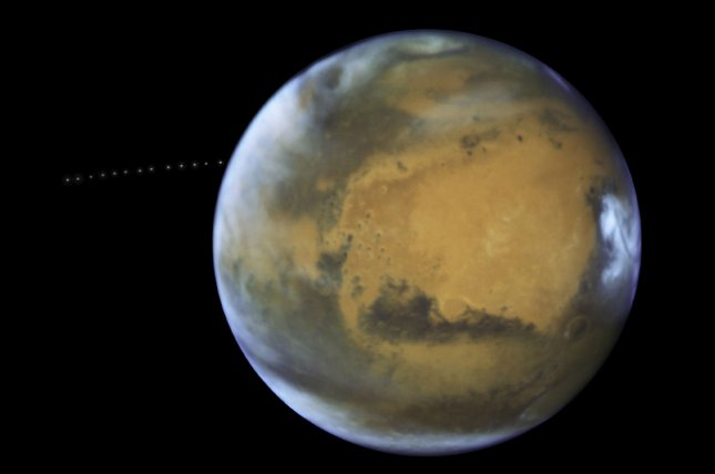 A new study revealed that Mars, shown here via the Hubble Space Telescope, may have four lakes of water under its surface in its southern pole region. Photo by NASA/UPI