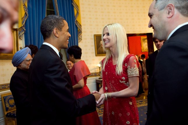 In this photo released by the White House on November 27, 2009, President Barack Obama greets Michaele and Tareq Salahi during a receiving line prior to a State Dinner for Indian Prime Minister Manmohan Singh (back,left) in the Blue Room at the White House in Washington on November 24, 2009. The Secret Service is looking into its own security procedures after the uninvited Virginia couple was able to get into the dinner. UPI/Samantha Appleton/White House